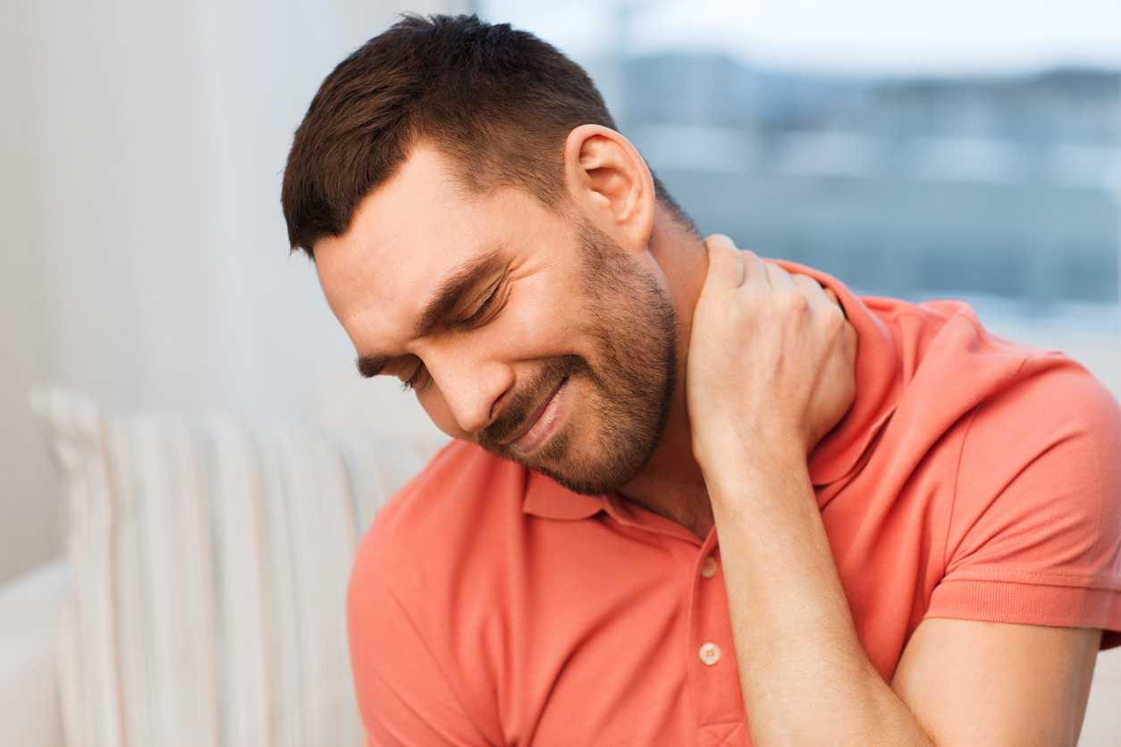 unhappy man suffering from wry neck